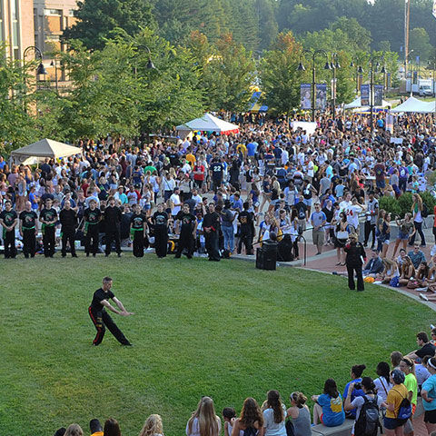 Aerial photo of a large crowd of people gathered on Risman Plaza on Kent's Campus with tables and tents set up
