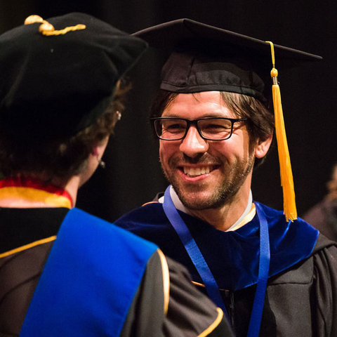 Matthew Lehnert receives the Distinguished Teaching Award in 2016.