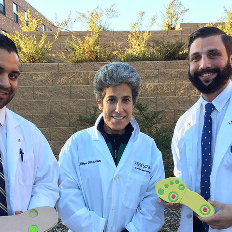 Kent State University students Nilin Rao (left) and Craig Verdin (right), and Exercise Science and Physiology Professor Ellen Glickman, Ph.D. (center), have invented an insole to help people with ulcerations on their feet.