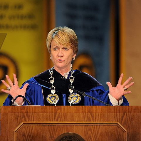 Kent State President Beverly Warren graciously accepts the applause of faculty, staff, students, alumni and distinguished guests during her inauguration ceremony in the Memorial Athletic and Convocation Center.