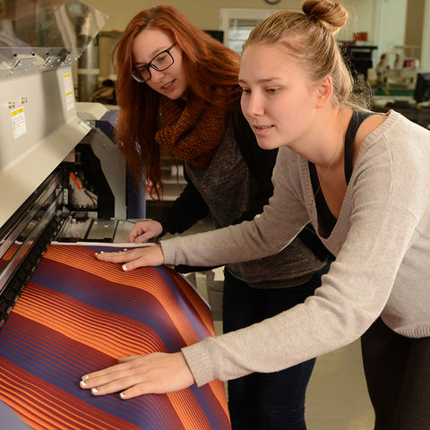 Students work on a project in the Fashion School's TechStyleLAB.