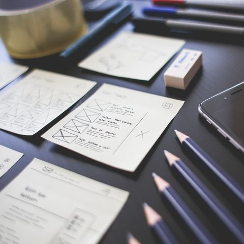 UX Wireframing and Sketching with mobile phone to the side