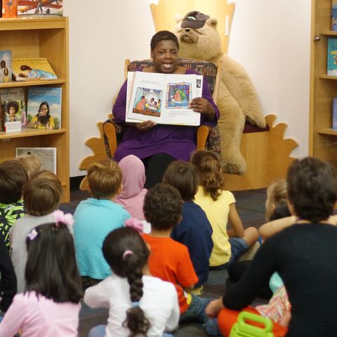 Angela Johnson, SLIS writer in residence, reads to children in the Marantz Picturebook Collection room.