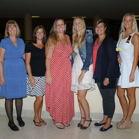 Newly pinned Kent State nursing graduate Kimberly Zelonis (right), will be following in the footsteps of her mother, aunt, and four sisters who are all nurses.