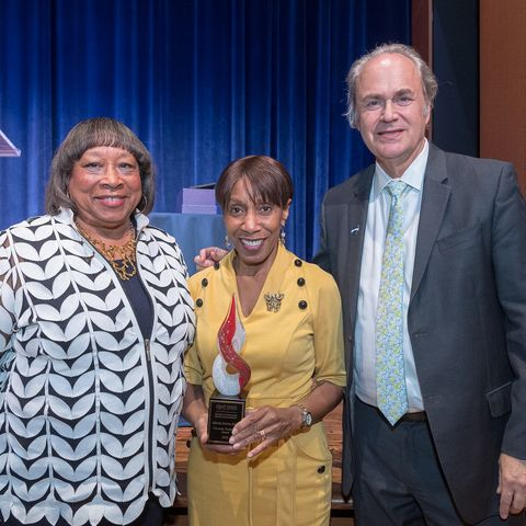 Alfreda Brown (center), Kent State University's vice president for diversity, equity and inclusion, receives the 2020 Diversity Trailblazer Award. She is pictured with Patricia Ackerman (left) and Kent State President Todd Diacon (right).