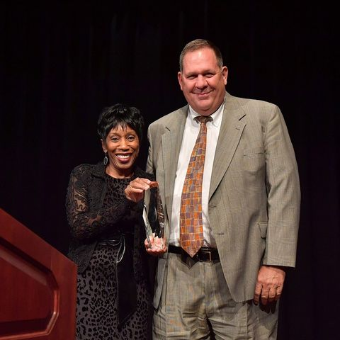 Kent State's Vice President for Information Services Ed Mahon accepts the Unity Award for Diversity on behalf of the division from Vice President for Diversity, Equity and Inclusion Alfreda Brown.