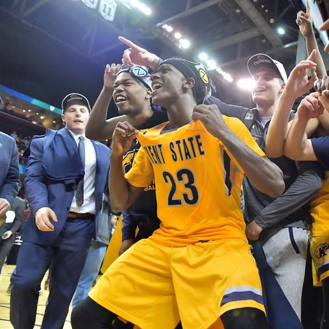 Members of the Kent State men's basketball team celebrate winning the 2017 Mid-American Conference Men's Basketball Tournament.