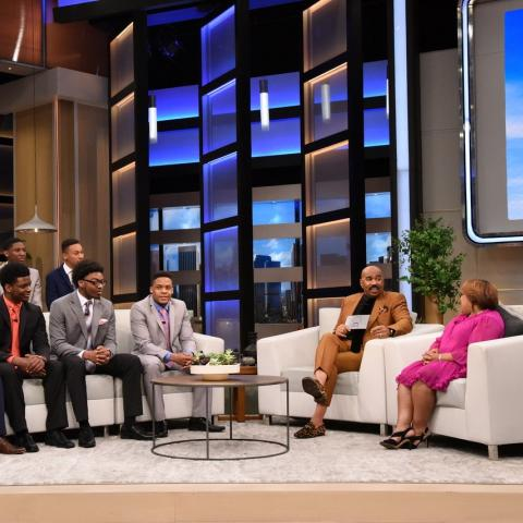 "Steve Harvey shares a joke with the eight scholarship recipients who will be attending Kent State this fall as Sonya Williams (far right) from the Division of Diversity, Equity and Inclusion looks on. (Photo provided by the ""Steve"" television show)"
