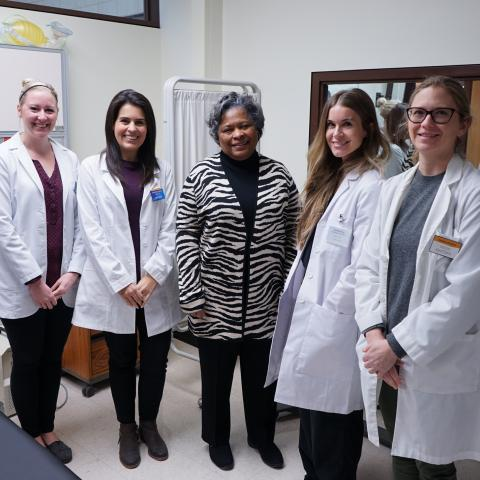 Standing in the middle, Barbara Broome, Ph.D., RN, FAAN, dean and Henderson Memorial Endowed Chair of Kent State University's College of Nursing, visits with graduate students before their simulation experience begins in this January 2020 photo.