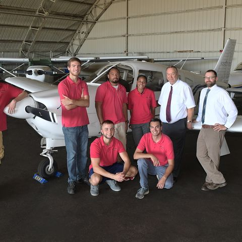 Staff and students pose with an airplane at the Kent State University Airport. The Kent State University Airport has been named Airport of the Year by the Ohio Aviation Association.