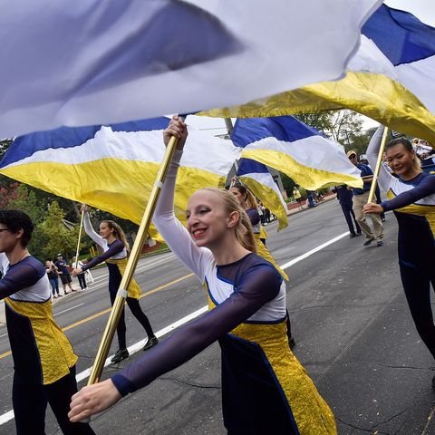 Members of the Kent State University Marching Golden Flashes make their way down Main Street during the 2018 Homecoming Parade.