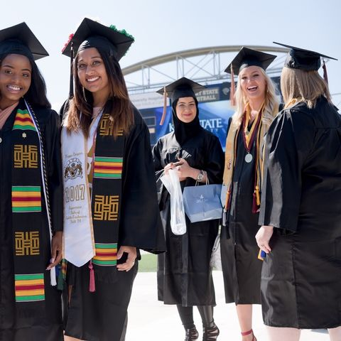 Kent State University students file into Dix Stadium for their Commencement ceremony this past May. Kent State has been selected as a recipient of the 2017 Higher Education Excellence in Diversity (HEED) Award from INSIGHT Into Diversity magazine.