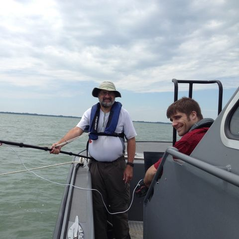 Kent State University Geology Professor Joseph Ortiz, Ph.D., and student Andrew Congdon take a few moments between collecting measurements of surface reflectance in Sandusky Bay this summer. (Photo credit: Sunny Dickerson, Bowling Green State University)