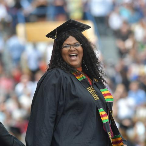 A graduating Kent State University student celebrates during her commencement ceremony in May 2018 at Dix Stadium.