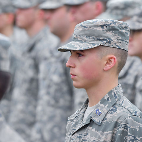 Members of the Kent State University ROTC stand at attention during the playing of the Armed Forces Medley, part of the university's annual observance of Veterans Day. This year's Veterans Day observance occurs Nov. 9 at the Kent Student Center Kiva.