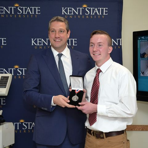 U.S. Rep. Tim Ryan displays the Congressional Award Silver Medal, presented to Kent State University nursing student Austin Croft in Henderson Hall, home of the College of Nursing.