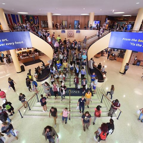Kent State University students fill the steps of the Kent Student Center during peak hours at the beginning of the 2017 Fall Semester.