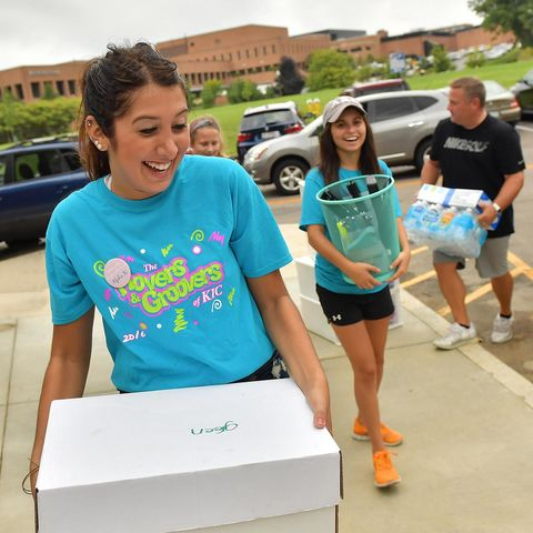 Volunteers called Movers and Groovers help new Kent State students and their families move items into the residence halls.