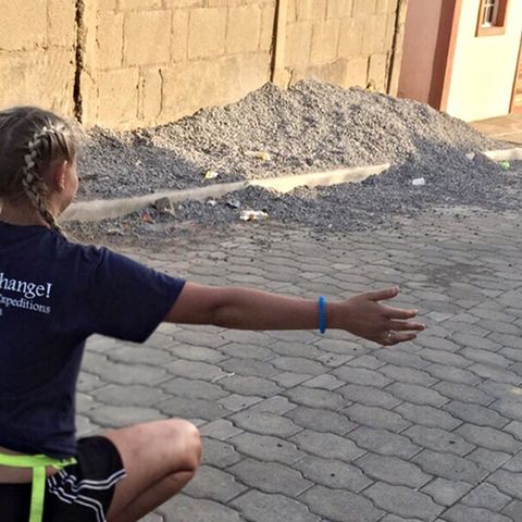 Kent State student Riley Jernejcic stretches out her arms to hug her new friend during a trip to Nicaragua. The trip was coordinated by the Office of Experiential Education and Civic Engagement.