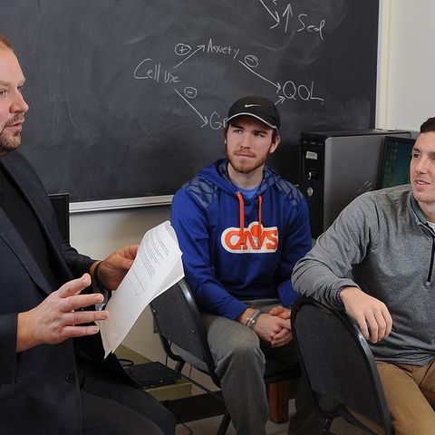 Jacob Barkley (left), associate professor of exercise science in Kent State's College of Education, Health and Human Services, oversees research activities with several students in a classroom in the MAC Center Annex.