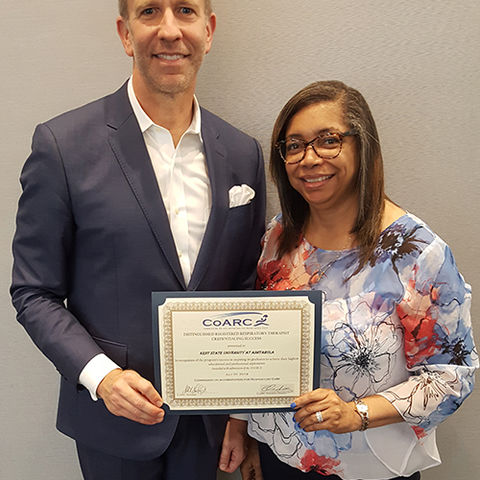 Ashtabula Respiratory Therapy Program Director Dr. Yvonne George (r) received the CoARC Distinguished Credentialing Award on behalf of the program