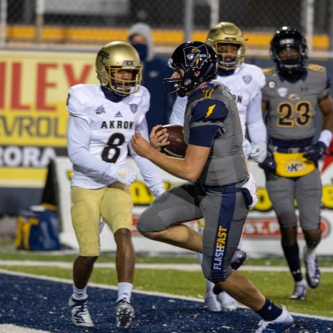 Kent State Quarterback Dustin Crum runs for a first half touchdown in the Golden Flashes win over Akron at Dix Stadium.
