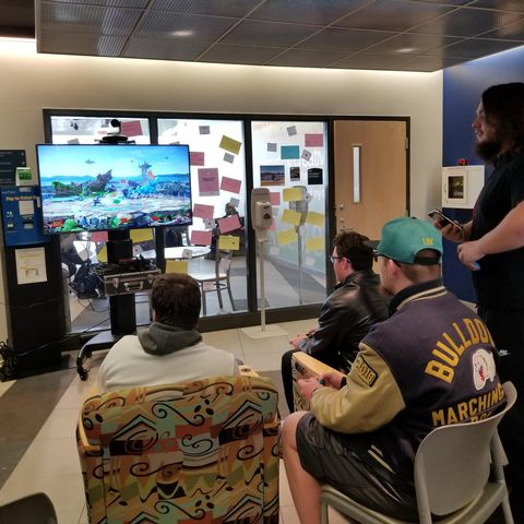 Students playing video games in lobby