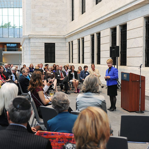 Kent State President Beverly Warren asks attendees to share their thoughts about Kent State at the Presidential Listening Tour alumni event at the Cleveland Museum of Art.