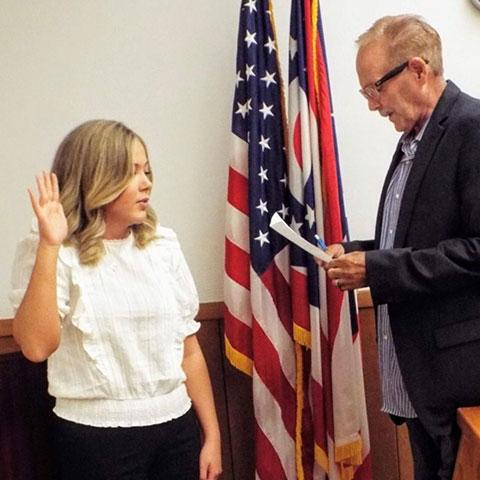 Maia Amato is sworn in as the newest member of the Wellsville Village Council by Mayor Randy Allmon.