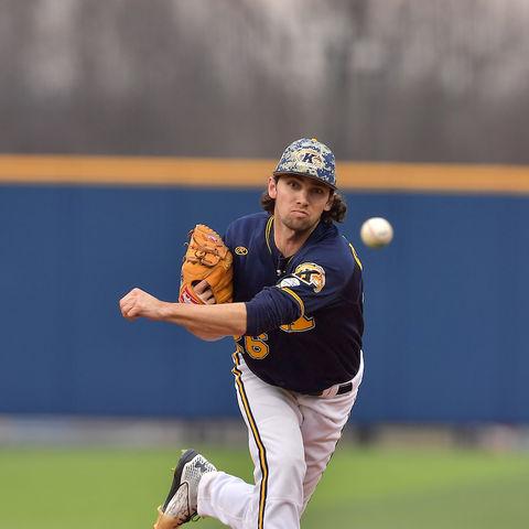 A Kent State pitcher hurls a ball toward the plate