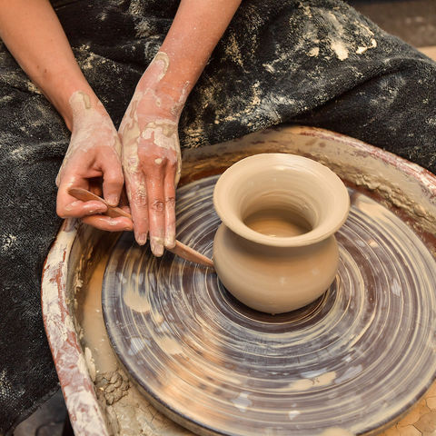 Doctoral Student Michelle Bebber works at the Eren Lab's pottery wheel