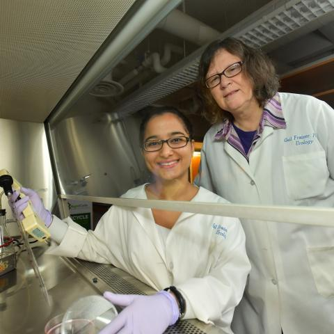 A student and professor work in the lab together.