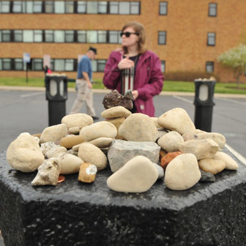 A Kent State student stands vigil at the spot where Allison Krause was shot on May 4, 1970.