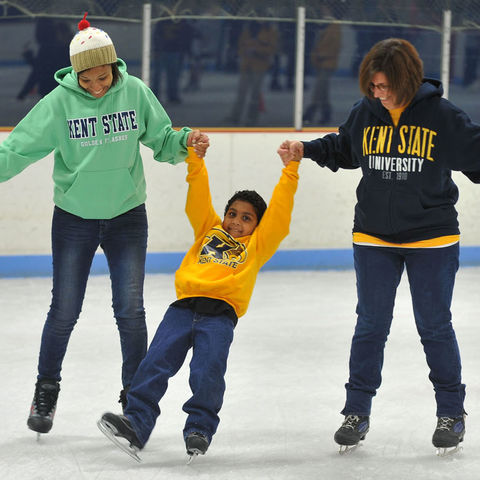 Kent State students and their family members skate at the ice arena during Lil' Sibs Weekend.