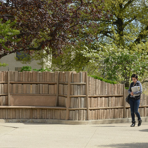 """A Kent State student walks through the """"Behind the Brain Plaza"""" near Merrill Hall."""