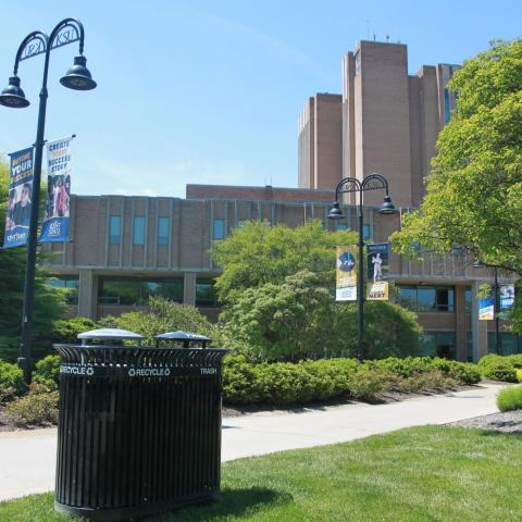 Recycling bins outside the Kent State University Library