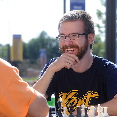 Members of the Kent State Chess Club enjoy a game while attending the 32nd Annual Black Squirrel Festival on Risman Plaza.
