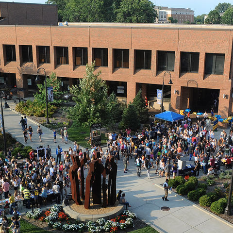 Thousands of Kent State students work their way through Risman Plaza during Blastoff, the annual back-to-school celebration held on the Student Green and Risman Plaza.
