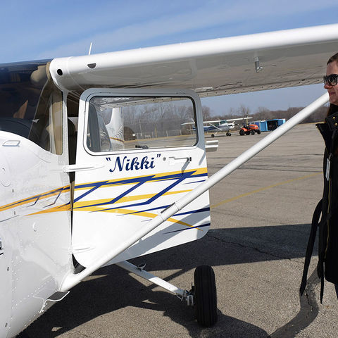 A Kent State aeronautics student looks over Nikki, the university's new aircraft, on the tarmac at the Kent State Airport. The student will be flying the plane in the 2016 Air Race Classic.