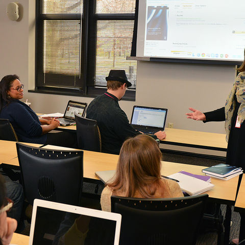 Danielle Sarver Coombs, associate professor in Kent State's School of Journalism and Mass Communication, lectures in a Franklin Hall classroom during an afternoon journalism class.