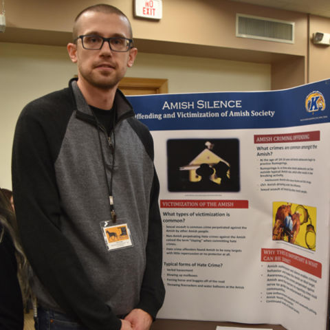 John Priddy took first place for his research paper that accompanied his poster.