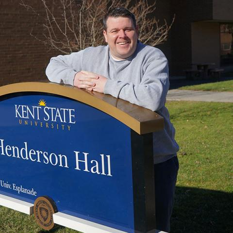 Curtis Good, Ph.D., Assistant Dean of Operations & Student Services for Kent State College of Nursing,, stands outside Henderson Hall on the Kent campus.