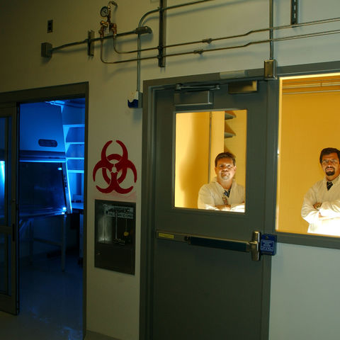 Dr. Chris Woolverton, associate professor of Biological Sciences, and Dr. Oleg Lavrentovich, Director of the Liquid Crystal Institute, pose in the entrance of the newest biology lab on the Kent State Campus.