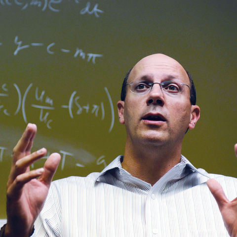 Michael Ellis, an associate professor of economics at Kent State University teaches a class in the College of Business.