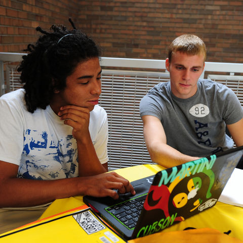Two students study in the College of Business.