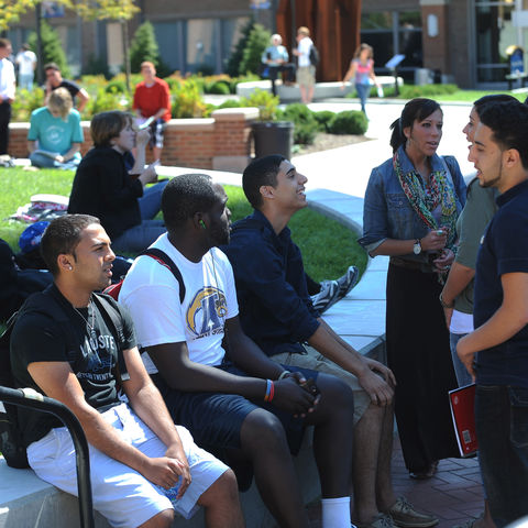 A group of international students shares a laugh during lunch time in the Risman Plaza.