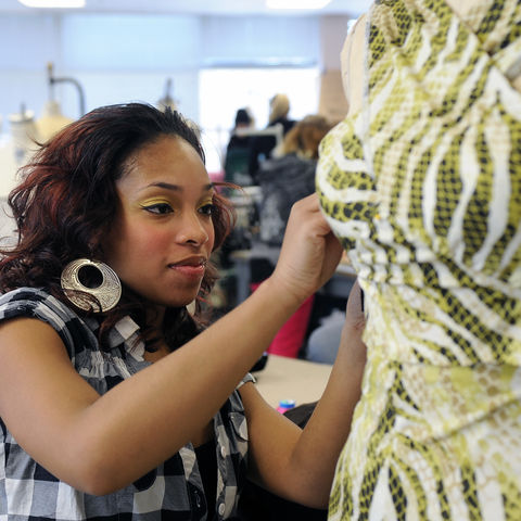 A fashion design student works on a garment in the studios in Rockwell Hall. The student was part of a group of fashion design students participating in a trip to China.