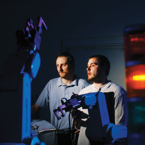 Two students work in one of the robotics labs in the College of Applied Engineering, Sustainability and Technology.
