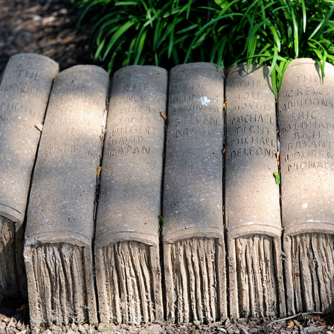Concrete books sit in a Kent State University courtyard, designed by artist and professor Brinsley Tyrrell.
