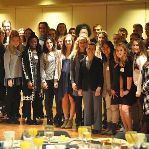 Kent State student-athletes with a 4.0 GPA celebrate their academic achievement with Kent State President Beverly Warren (front row, ninth from left) at a breakfast held in the Kent Student Center Ballroom Balcony.